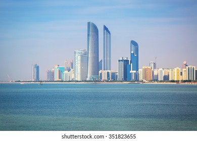 ABU DHABI, UAE - MARCH 29, 2014: Cityscape of Abu Dhabi, capital city of UAE. Abu Dhabi is the capital and the second most populous city in the United Arab Emirates with around 1 million people.