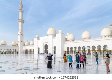 Abu Dhabi, UAE - March 31. 2019. Tourists in the square in front of Sheikh Zayd Grand Mosque