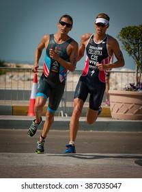 ABU DHABI, UAE (MARCH 5, 2016) -- Manuel Huerta (PUR) and Jan Celustka (CZE) in the season opening race for the 2016 ITU World Triathlon Series in Abu Dhabi.