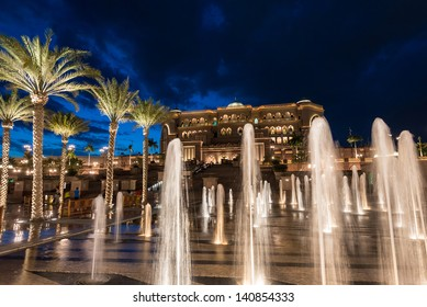 ABU DHABI, UAE - MAY 1: Emirates Palace hotel with fountain on May 1, 2013. Emirates Palace is a luxurious and the most expensive 7 star hotel designed by renowned architect, John Elliott RIBA.