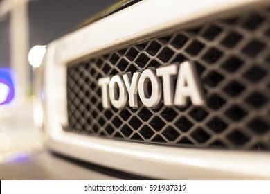 ABU DHABI, UAE - NOV 26, 2016: Toyota company logo on a car illuminated at night