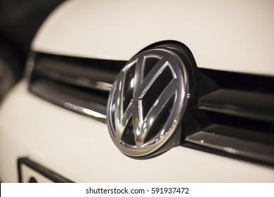 ABU DHABI, UAE - NOV 26, 2016: Volkswagen company logo on a car illuminated at night