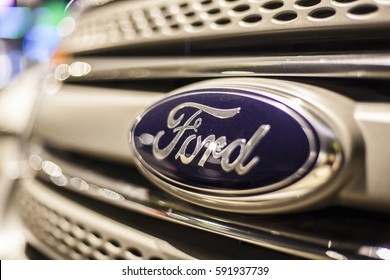ABU DHABI, UAE - NOV 26, 2016: Ford company logo on a car illuminated at night