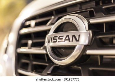 ABU DHABI, UAE - NOV 26, 2016: Nissan company logo on a car illuminated at night