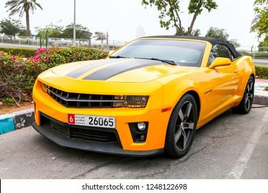 Abu Dhabi, UAE - November 17, 2018:  American muscle car Chevrolet Camaro in the city street.