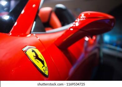 Abu Dhabi, UAE - November 21, 2016: Yellow Scuderia Ferrari logo on red Ferrari car