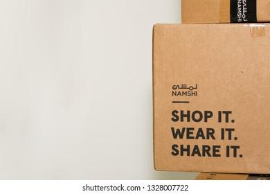 Abu Dhabi, UAE - November 26, 2018.  Namshi.com package box, one of the biggest online fashion shop in Middle East
