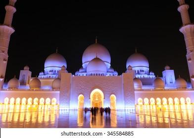 ABU DHABI, UAE - November 8: The Sheikh Zayed Grand Mosque glows at night on November 8, 2015 in Abu Dhabi, UAE.