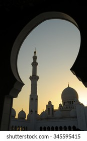 ABU DHABI, UAE - November 8: The silhouette of Sheikh Zayed Grand Mosque is framed at dusk on November 8, 2015 in Abu Dhabi, UAE.