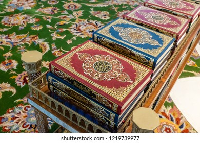 ABU DHABI, UAE - OCTOBER 11, 2014: Copies of the Qur'an (koran) in the Sheikh Zayed Grand Mosque in Abu Dhabi, the capital city of the United Arab Emirates