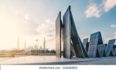 ABU DHABI, UAE - OCTOBER, 2018: Panoramic image of Wahat Al Karama (Oasis of Dignity), permanent memorial for its martyrs, and Shaikh Zayed Grand Mosque.