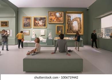 Abu Dhabi, United Arab Emirates,  JANUARY 04, 2018: People looking at exhibits in the new Louvre Museum in Abu Dhabi