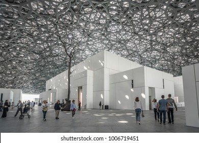 "Abu Dhabi, United Arab Emirates,  JANUARY 04, 2018:  Interior of the Louvre Museum, Abu Dhabi, showing reflections of the ""Rain of Light"" dome"