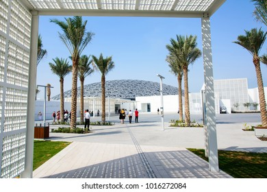ABU DHABI, UNITED ARAB EMIRATES - JANUARY 26, 2018: Louvre Abu Dhabi building exterior and entrance. New museum in United Arab Emirates opened on November 8th 2017