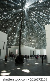ABU DHABI, UNITED ARAB EMIRATES - JANUARY 26, 2018: Lights passing through roof and ceiling of Louvre Abu Dhabi presenting Rain of Light design feature