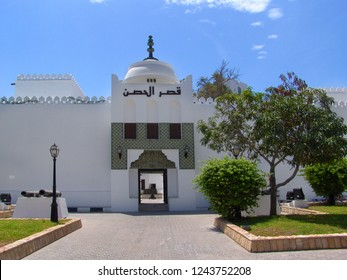 Abu Dhabi, United Arab Emirates - April 11, 2004: entrance gate of the historic white fort qasr al hosn in front of blue sky on a sunny day