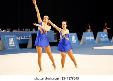 Abu Dhabi, United Arab Emirates - March 20, 2019: Rhythmic gymnasts perform during Special Olympics World Games in Abu Dhabi National Exhibition Centre.