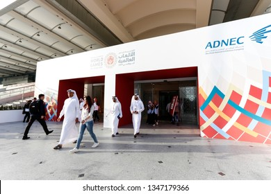 Abu Dhabi, United Arab Emirates - March 20, 2019: Arab men comes out Abu Dhabi National Exhibition Centre which holds Special Olympics World Games.