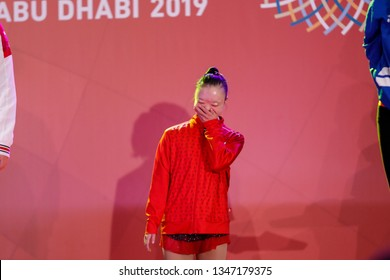 Abu Dhabi, United Arab Emirates - March 20, 2019: Gymnastic athlete from Canada cheers during decoration ceremony during Special Olympics World Games in Abu Dhabi National Exhibition Centre.