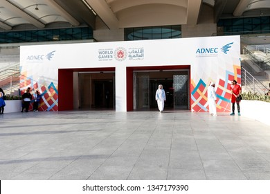 Abu Dhabi, United Arab Emirates - March 20, 2019: Arab Volunteer comes out Abu Dhabi National Exhibition Centre which holds Special Olympics World Games.