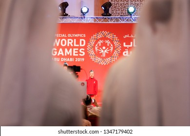 Abu Dhabi, United Arab Emirates - March 20, 2019: Arab men watch medal decoration ceremony during Special Olympics World Games in Abu Dhabi National Exhibition Centre.