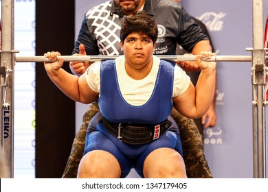 Abu Dhabi, United Arab Emirates - March 20, 2019: Female powerlifter from India compete during Special Olympics World Games in Abu Dhabi National Exhibition Centre.