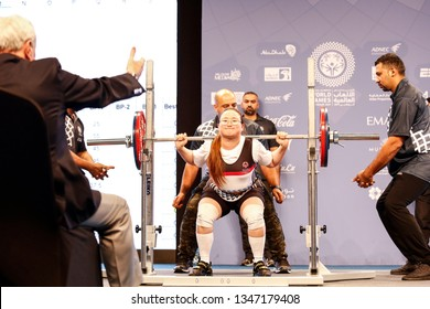 Abu Dhabi, United Arab Emirates - March 20, 2019: Female powerlifter from Korea compete during Special Olympics World Games in Abu Dhabi National Exhibition Centre.