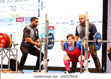 Abu Dhabi, United Arab Emirates - March 20, 2019: Female powerlifter from Iceland compete during Special Olympics World Games in Abu Dhabi National Exhibition Centre.