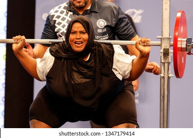 Abu Dhabi, United Arab Emirates - March 20, 2019: Female powerlifter from Lybia compete during Special Olympics World Games in Abu Dhabi National Exhibition Centre.