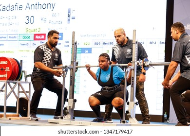 Abu Dhabi, United Arab Emirates - March 20, 2019: Female powerlifter from Trimidad and Tabago compete during Special Olympics World Games in Abu Dhabi National Exhibition Centre.