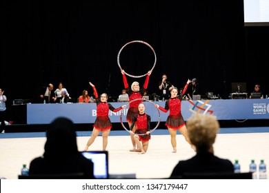 Abu Dhabi, United Arab Emirates - March 20, 2019: Rhythmic gymnasts perform during Special Olympics World Games in Abu Dhabi National Exhibition Centre,
