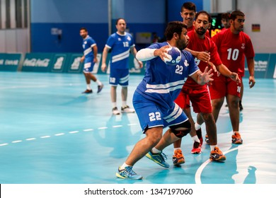 Abu Dhabi, United Arab Emirates - March 20, 2019: Kuwait handball team fights Oman during Special Olympics World Games in Abu Dhabi National Exhibition Centre.