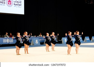 Abu Dhabi, United Arab Emirates - March 20, 2019: Rhythmic gymnasts from Great Britain perform during Special Olympics World Games in Abu Dhabi National Exhibition Centre