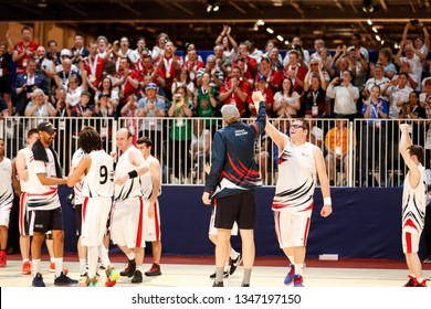 Abu Dhabi, United Arab Emirates - March 20, 2019: British basketball team cheers after winning finals during Special Olympics World Games in Abu Dhabi National Exhibition Centre.