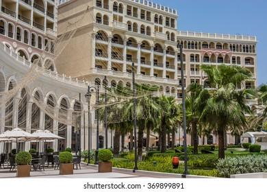 ABU DHABI, UNITED ARAB EMIRATES - SEPTEMBER 5, 2015: Beautiful area 5 stars Hotel Ritz-Carlton Abu Dhabi, Grand Canal (532 rooms, gardens with private beach, pool, gym and 10 restaurants).