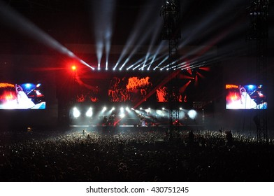 ABU DHABI, UNITED ARAB EMIRATES, OCTOBER 19, 2013, Warm Up Before Formula One Racing Week, Crowds, Rihanna Concert, Rays, Red, White Light, Singer Artist Stage, Screens, Documentary Editorial