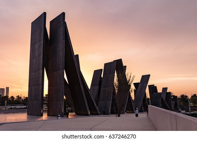 ABU DHABI, UNITED ARAB EMIRATES - MAY 8 2017: Sunset in Martyr's Memorial Park, in opposite of Sheik Zayed Grand Mosque in Abu Dhabi, UAE.
