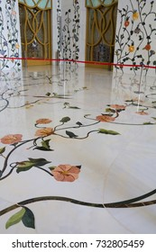 Abu Dhabi, United Arab Emirates, April 10,2013 Marble flooring White mosque in Abu Dhabi.  Marble floors and walls of the White mosque in Abu Dhabi is decorated with mosaics inlaid with  stones, gems.