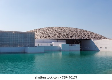 "Abu Dhabi, United Arab Emirates, November 14, 2017: Louvre Abu Dhabi. View of the Louvre, showing the ""Rain of Light"" Dome."