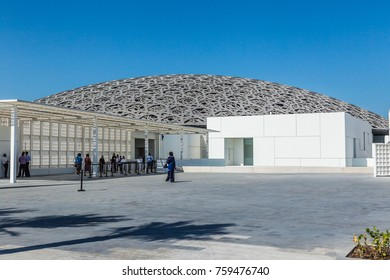 Abu Dhabi, United Arab Emirates, November 14, 2017: Louvre Abu Dhabi. Visitors approaching the entrance to the Louvre.