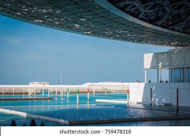 Abu Dhabi, United Arab Emirates, November 14, 2017: Louvre Abu Dhabi. Boat dock outside the Louvre,  enabling access by sea.