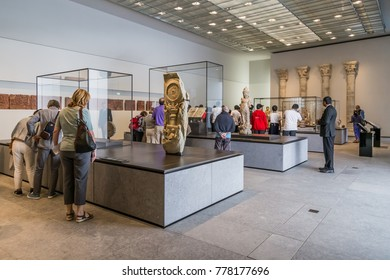Abu Dhabi, United Arab,  Emirates, December 5, 2017: The Louvre. Visitors in the 4th Gallery of the Louvre, dedicated to Universal Religions.