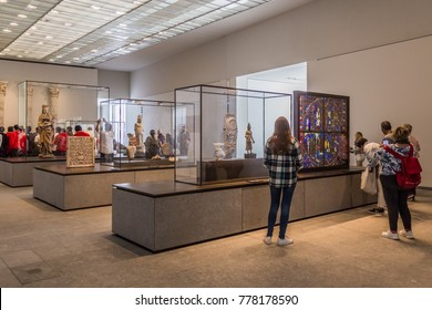 Abu Dhabi, United Arab,  Emirates, December 5, 2017: The Louvre. People looking at exhibits in the 4th Gallery of the Louvre, dedicated to Universal Religions. ,