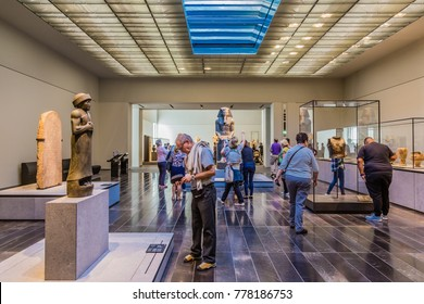 Abu Dhabi, United Arab,  Emirates, December 5, 2017: The Louvre.  Visitors looking at exhibits in the 2nd Gallery of the Louvre, dedicated to The First Great Powers.