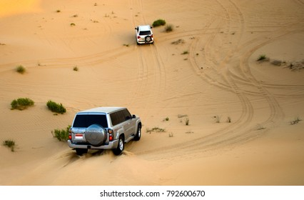 ABU DHABI, UNITED ARAB EMIRATES - DEC 30, 2017: Four wheel drive through the desert in the United Arab Emirates.