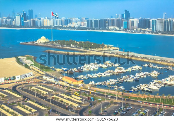 Abu Dhabi, United Arab Emirates - April 21, 2013: panoramic view of Marina of Abu Dhabi from Marina Mall Tower, shopping mall. Boats and luxury yachts docked at harbor. Skyline background.