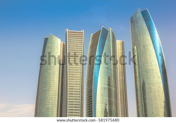 Abu Dhabi, United Arab Emirates - April 21, 2013: Etihad Towers, a complex of buildings with five towers.High rise modern buildings in the blue sky. Finance and business concept. Urban city background