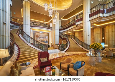 ABU DHABI/UAE - April 7, 2019: Interior of St.Regis Hotel main lobby with a titanic staircase