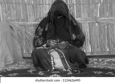 Abu Dhabi/UAE/01-27-2018: Emirati Woman is weaving traditional basket