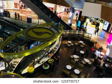 Abu Dhabi,U.A.E.-October 22nd, 2018: Abudhabi Al Wahda Mall interior and coffee shops in the lobby. View from first floor.